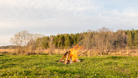 A bonfire in the field near the river