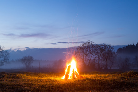 The bonfire flares up and goes out. The night is coming.