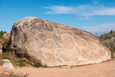 고대 그림, Issyk-Kul, Cholpon-Ata, Kyrgystan 근처 바위에 암각화 스톡 콘텐츠