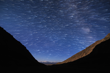 Traces from stars in the form of fading lines. View in the mountains. Kyrgyzstan
