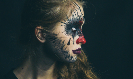 Portrait of a girl in makeup. Halloween, the face of a girl is a doll, the floor of a face is dead Stock Photo