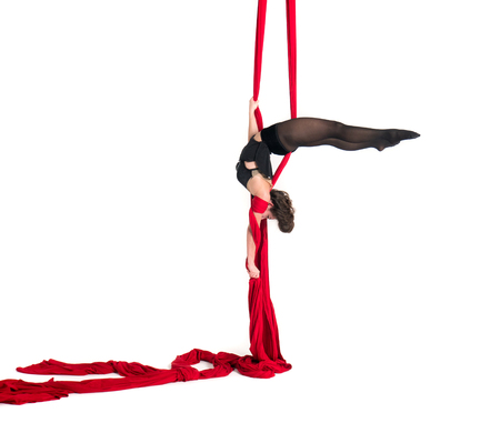 Woman hanging in aerial silks, isolated on white. Beautiful geometric poses.