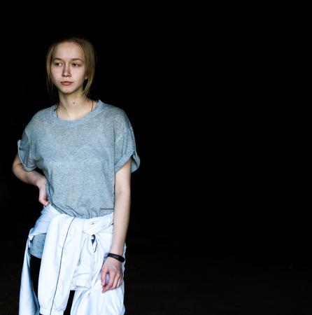 Young girl in a dark cave Reklamní fotografie