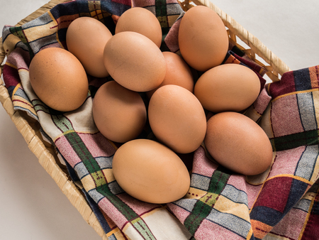 eggs in a straw basket on a table