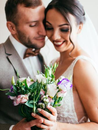 Bride and groom embrace emotions Standard-Bild - 117770227