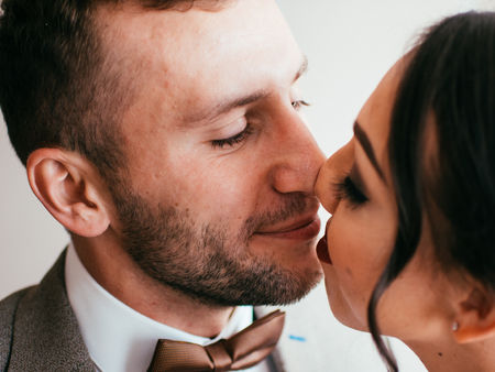 Bride and groom embrace emotions