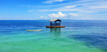 House in the middle of the Sea. Paradise View. Blue Sky. Turquoise Water.