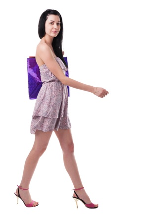 Young woman  walking with shopping bags Stock Photo