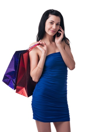 Young woman with shopping bags and phone Stock Photo