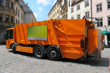 garbage truck in the city street Stock Photo