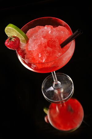 Strawberry margarita cocktail on black background photo