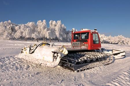 Big snowplow at the ski slope photo