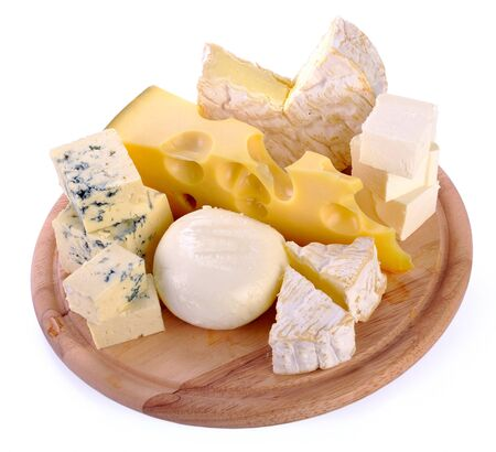 a set of cheese on a wooden board