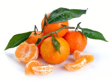 clementines with segments with drop on a white background photo