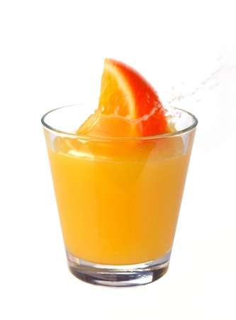 orange juice splash on a white background photo