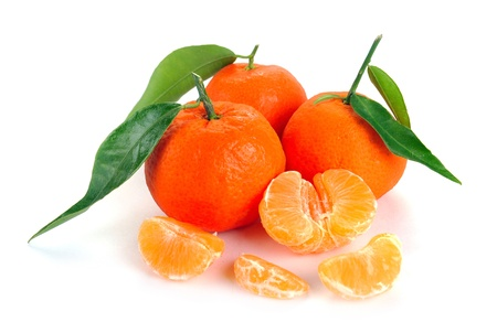 clementines with segments on a white background