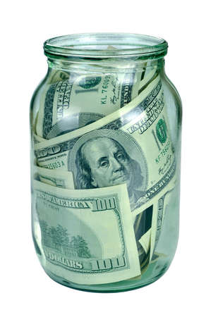 Canned money. Dollar banknotes inside glass jar photo