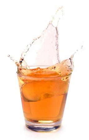 apple juice splash on a white background photo