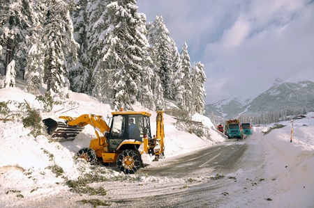 clearing roads of snow and fallen tree photo