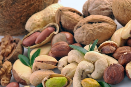 Peanuts, cashews, pistachio, almonds, walnuts, coconut, Brazil nuts and hazelnuts on a white background