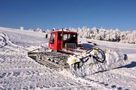 Big snowplow at the ski slope 免版税图像