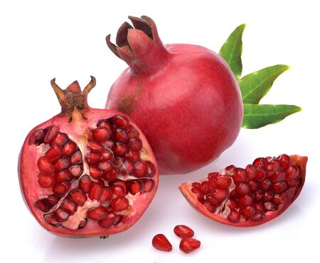 Pomegranate whole and open-face with seeds on a white background Stock Photo - 13610457