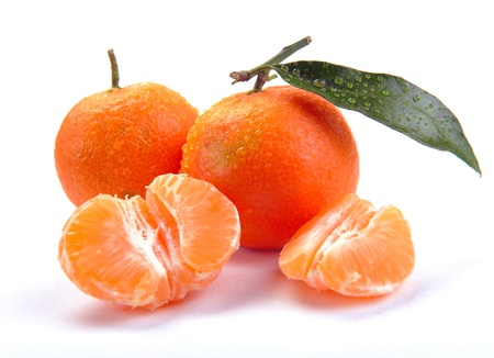 clementines: clementines with segments with leaves on a white background Stock Photo