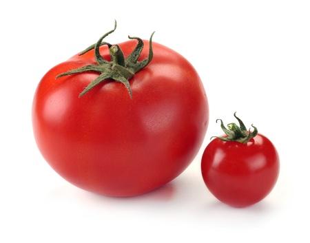 tomate grande y pequeño en el fondo blanco Foto de archivo