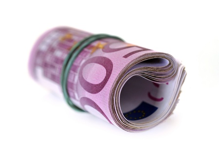 Roll of money and bow on white background photo