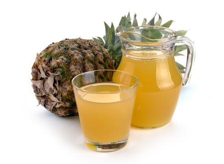 Full glass and jug of pineapple juice on a white Stock Photo - 13648454