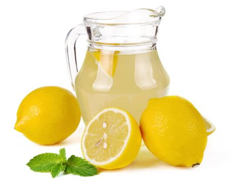 lemon juice in a jug and fruit photo
