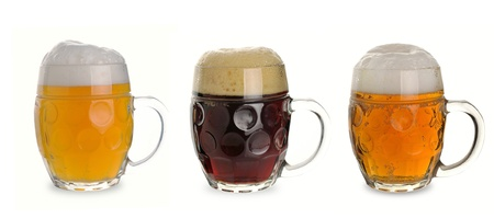 three mug of dark, white, light beer on a white background