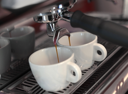 coffee machine: Espresso pouring into a cup