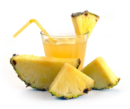 Full glass of pineapple juice on a white