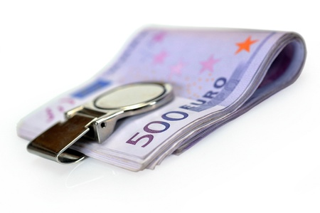 euromoney: Bundle of 500 Euro bank notes fasten with money clip isolated on white background
