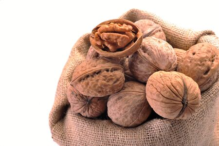 Walnuts in the tissue sac on a white background Stock Photo - 13759844