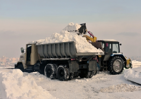cleaning and snow loading on the truck photo