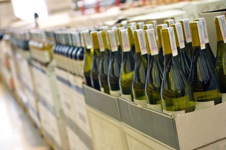 Red and white wine in bottles in wine shop Stock Photo