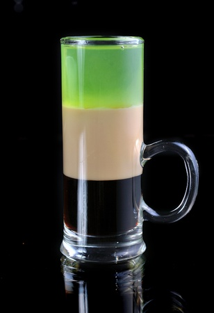 B-52 Shot  Short drink to serve at the evening  Ingredients  1 4 measure coffee liqueur, 1 4 measure Irish Cream, 1 4 measure absinthe photo