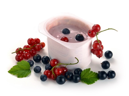 yogurt with berries on a white background photo