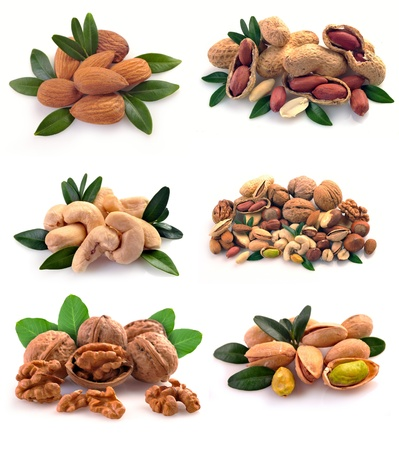 Peanuts, cashews, pistachio, almonds, walnuts, Brazil nuts and hazelnuts on a white background photo