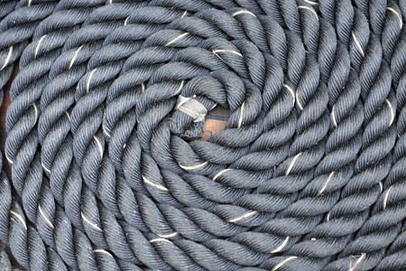 sailingboat: Thick rope wrapped in a spiral on the ships deck Stock Photo