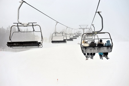 Ski lift chairs on snow winter day Stock Photo
