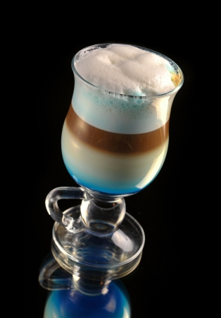 cocktail with coffee and whipped milk and liqueur curacao Stock Photo - 16389856