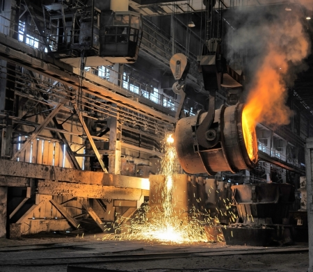 red hot iron: smelting of the metal in the foundry Stock Photo