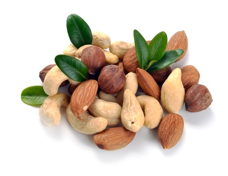 Peanuts, cashews,  almonds, walnuts and hazelnuts on a white background photo