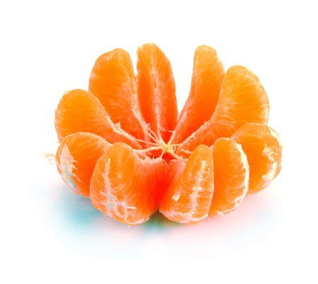 segments clementines on a white background photo