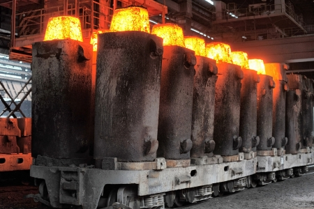 heated: forms from the heated steel pigs from a railway platform Stock Photo
