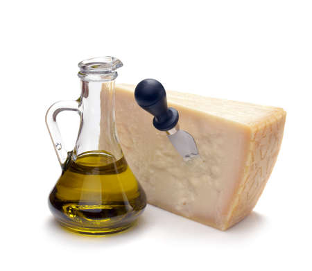 parmesan cheese and olive oil on a white background Stock Photo - 18948675