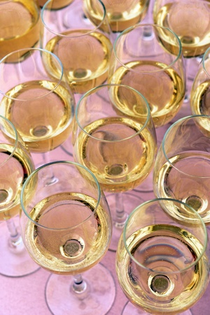Glasses with wine on table - party background photo